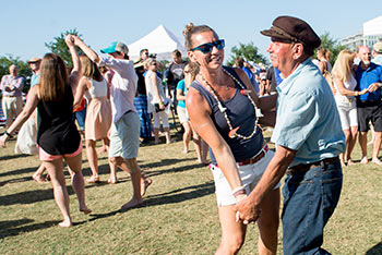 Melissa Magwood and her father dancing at the Blessing of the Fleet Festival.